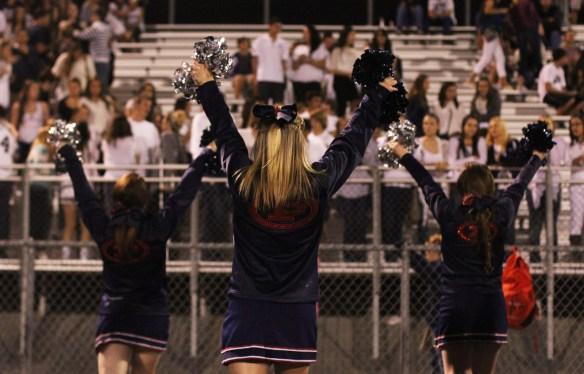 Cheerleaders perform at a Pinnacle High School football game.