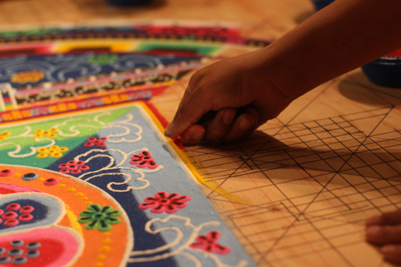Tibetan monks create a sand mandala at the Combine Studios for the 26th annual Art Detour weekend.