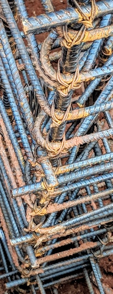 The rebar columns have been tied by hand. This gives them some seismic sway. The rebar columns will be encased in cement, and a metal plate will be welded at the top, giving them stability.