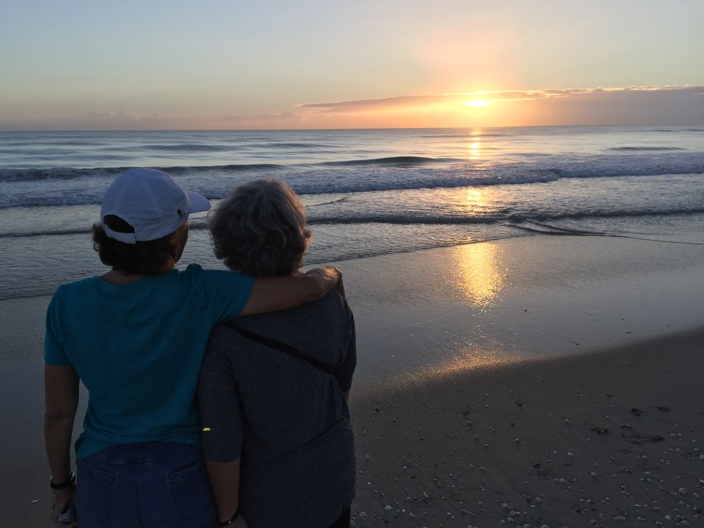 Barbara and Mom watching the sunrise on South Hutchinson Island, Florida