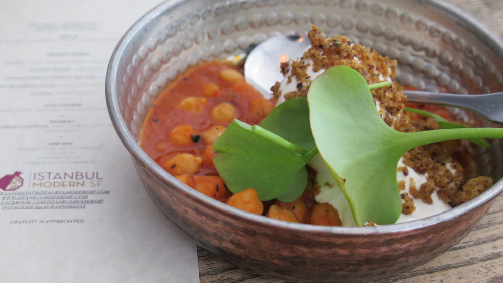 Jilbir - Soft-boiled egg with tomato sauce, chickpeas, and garlic yogurt
