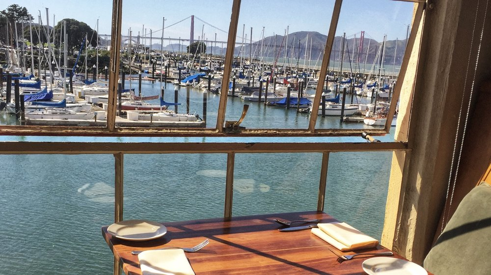 View of the Golden Gate Bridge through the marina while dining at Greens Restaurant