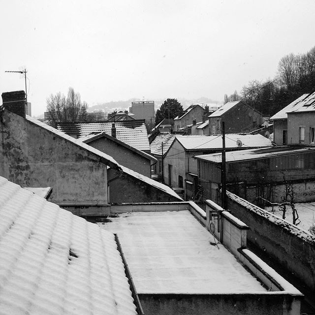 Four years ago, on French rooftops, with a fresh dusting of snow.