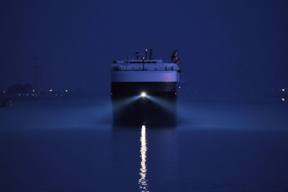 "During an early November morning, the 60,000 ton vehicle carrier ""Metis Leader"" follows us through the Suez Canal on her way to Jeddah, Saudi Arabia and Sohar, Oman. The smooth and incident-free operation of this 193 km (120 mi) long marine highway is vital to Egypt's reputation and income. Security is tight along the entire canal with armed soldiers on duty on both sides of the Suez."