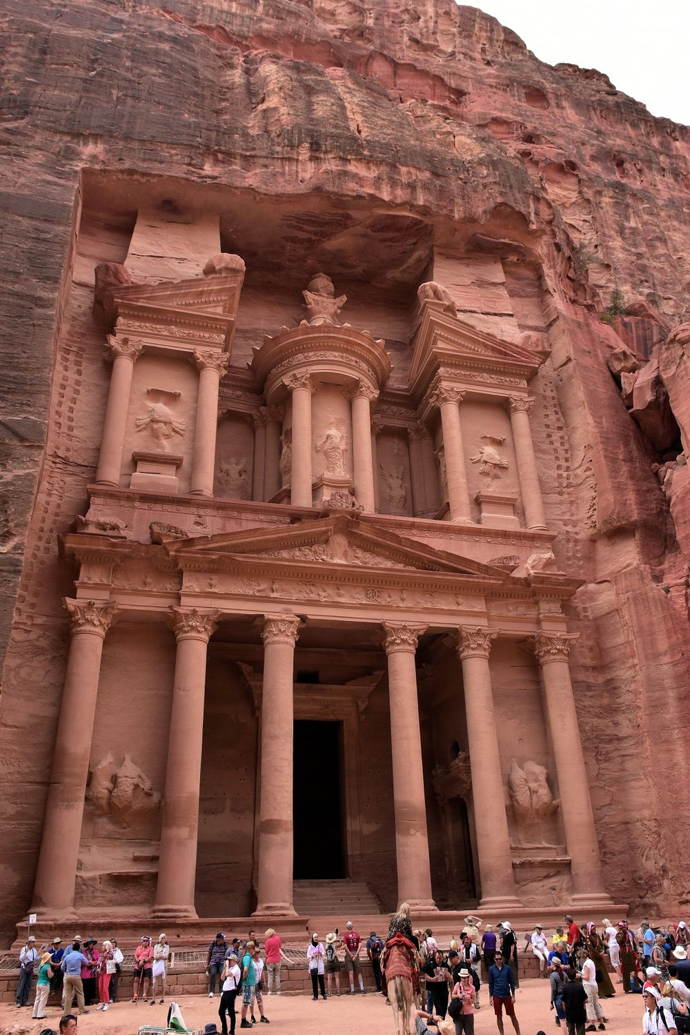 The Khazneh (Treasury) is the most prominent of all the sandstone facades in the famed city of Petra. After being ignored and forgotten for close to 2,000 years, many questions remain with respect to the time of its creation and its purpose. However, the numerous funerary images carved into the structure lead us to conclude that the building was used in association with the Nabataean Cult of the Dead.