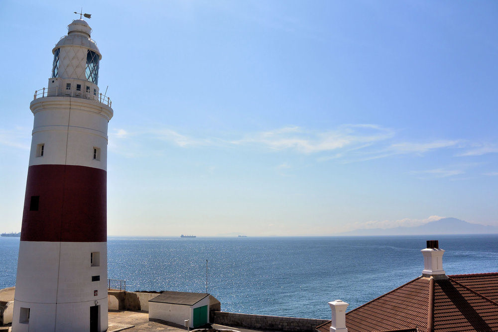 "The view from ""Europa Point"" across the Strait of Gibraltar. The coastline of Africa (Morocco) can be seen at the lower right."