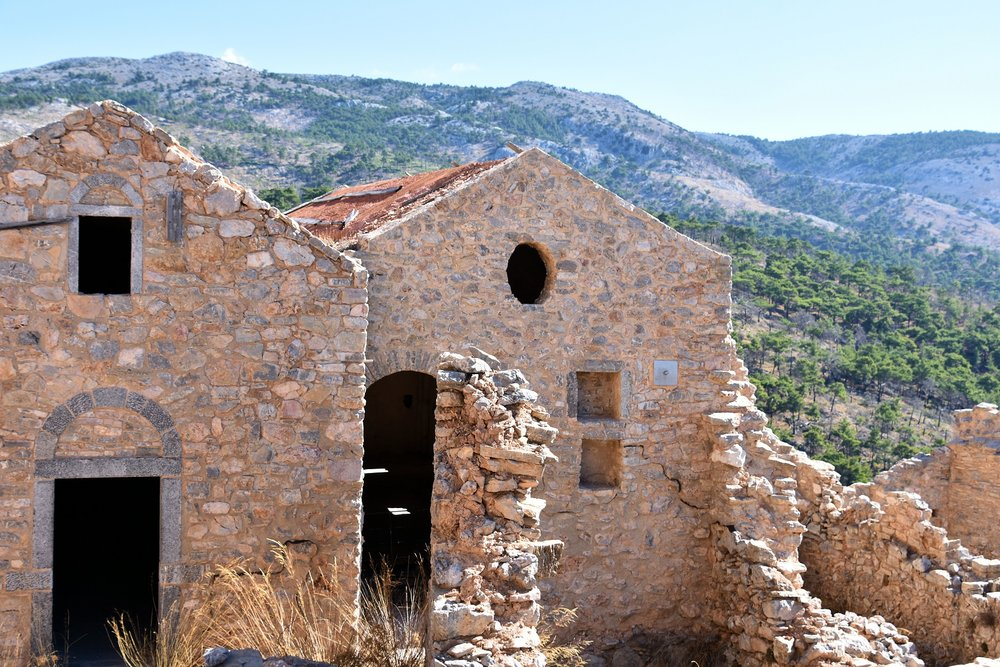 "The abandoned medieval village of Anavatos on the Greek island of Khios is located high on a rock cliff for protection from enemy forces and pirates. It was home to people were employed at the local monastery. Now, the homes are disintegrating and the rock paths are difficult to walk, but since the village has become a UNESCO World Heritage Site, repair work has finally started. The village was also the setting for the James Bond movie ""For Your Eyes Only""."