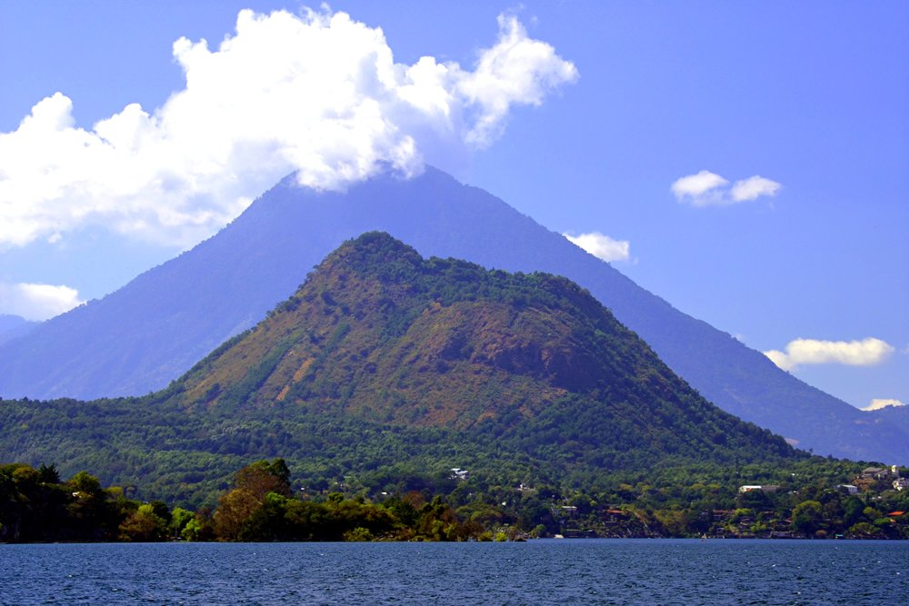 Volcanoes with Lake Atitlan in the foreground.