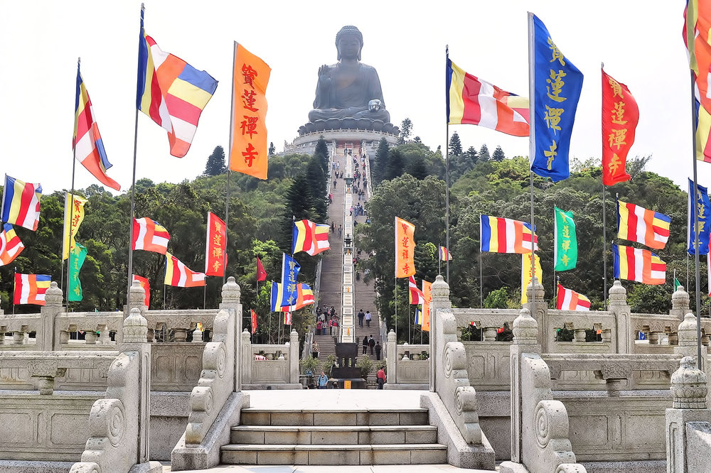 The Tian Tan Buddha on Lantau Island, Hong Kong. The Buddha statue is 34 m (111 ft) tall and is made out of bronze. The construction of the statue was completed in 1993.