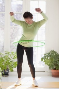 Woman exercising with hula hoop
