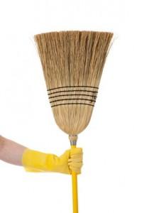 Hand holding Broom - Chore or housework theme