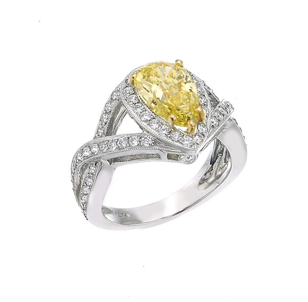 2.10ct fancy yellow intense pear shape diamond ring copy.jpg