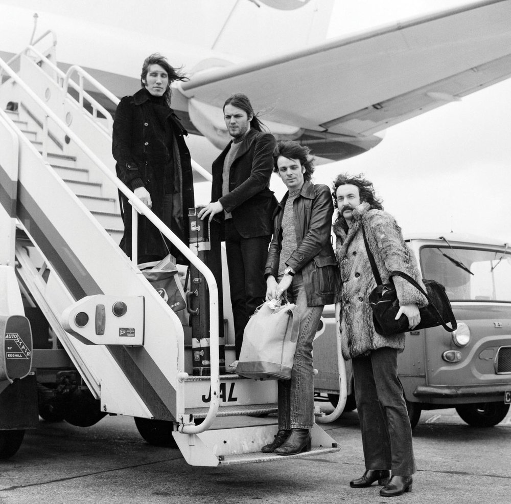 PHOTO: The band prepares to board a DC-8 jet airliner for a 12-day tour in Japan, on March 3, 1972. They had all of the plane's 114 seats to themeslves. - Newsweek