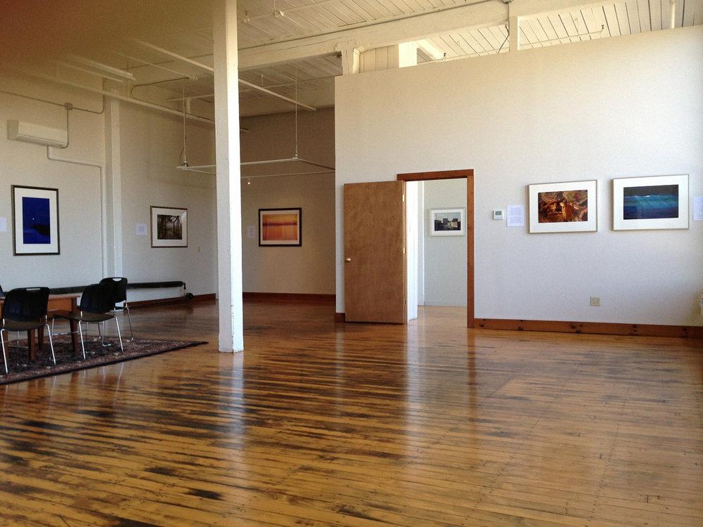 """ Availaflex "" De-Vel-Op-Ment Exhibition Space  Current Shows: Reimagine New England  - Photography; Boston Color  - Photography; Two Stools  - Installation Art"