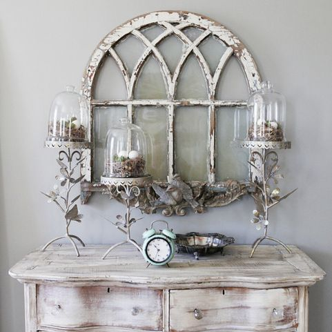 with this trend you can do anything from a subtle photo frame with a windowpane style to a full vintage window with the glass removed - Distressed Window Frame