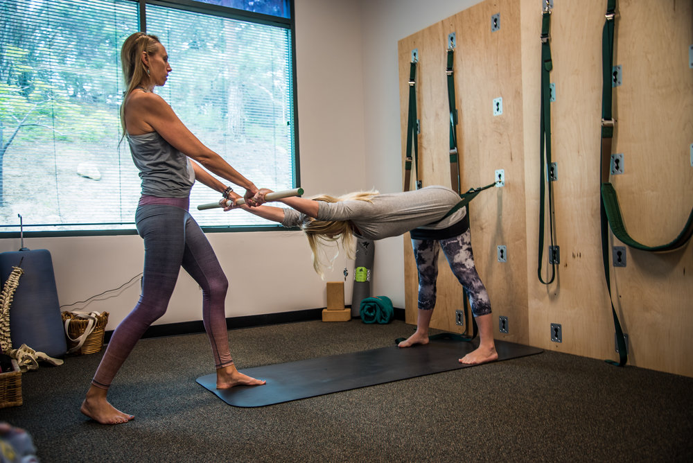 Utilizing the Great Yoga Wall with a patient with Scoliosis in Encinitas