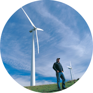 Wind farm and farmer, by image library, cc..png