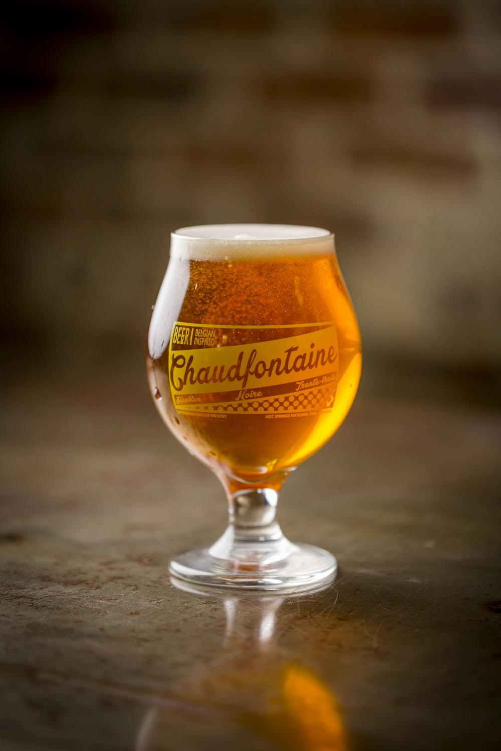 Chaudfontaine Houblon - A Belgian-style Imperial IPA or if you prefer, a hopped Tripel.  Our Bagstone yeast (urportedly from the Orval brewery in Belgium) creates fruit and spice characteristics underneath an explosion of Chinook hops