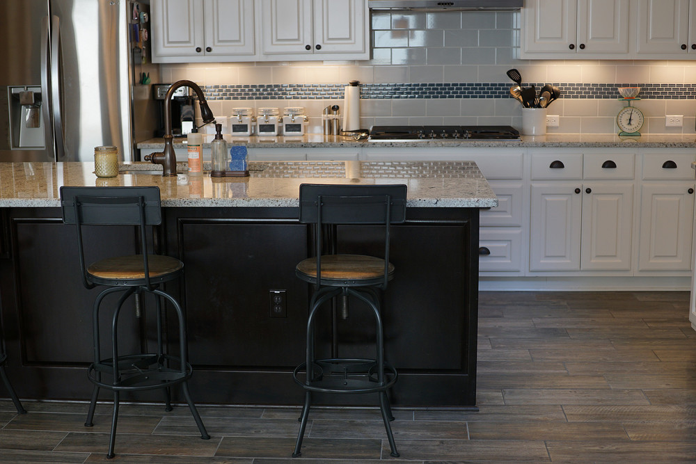 a darker wood for our nearly 9 foot island  the countertop is a grey ish granite and the backsplash is a mix of blue glass and grey subway tiles  our home tour  kitchen and dining room  u2014 being brauns  rh   beingbrauns com