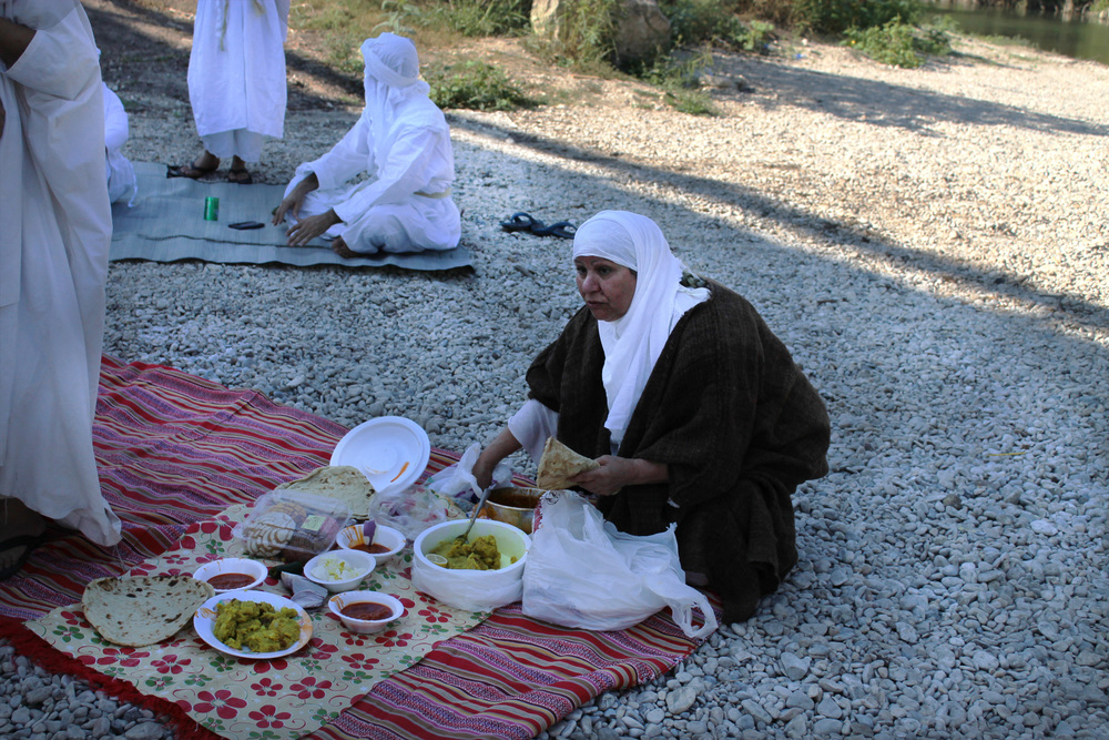 After the baptism, everyone gathers for lunch. Most of the Mandaeans live in the same neighborhood in San Antonio and shop at the local H-E-B. But they still mostly eat their traditional, largely vegetarian dishes.