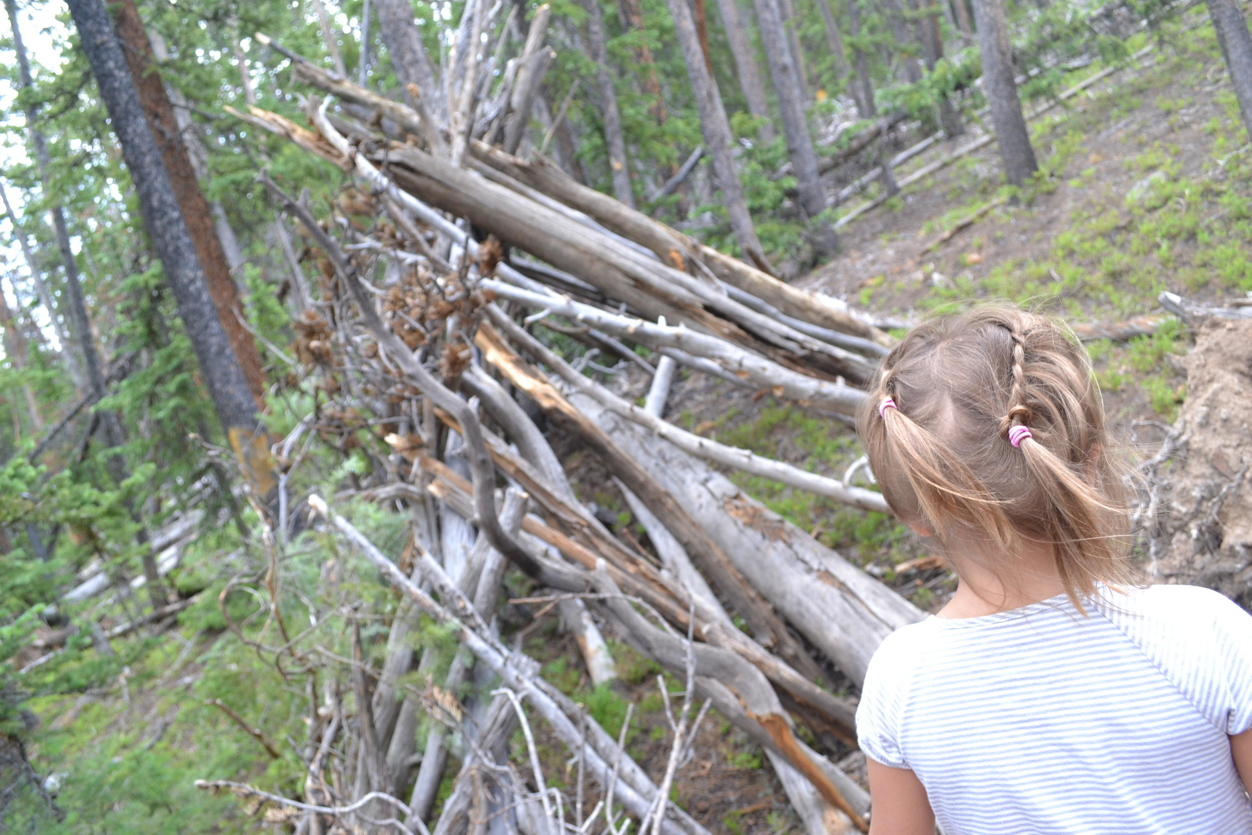 A girl looks at a homemade fort in Breckeneridge CO