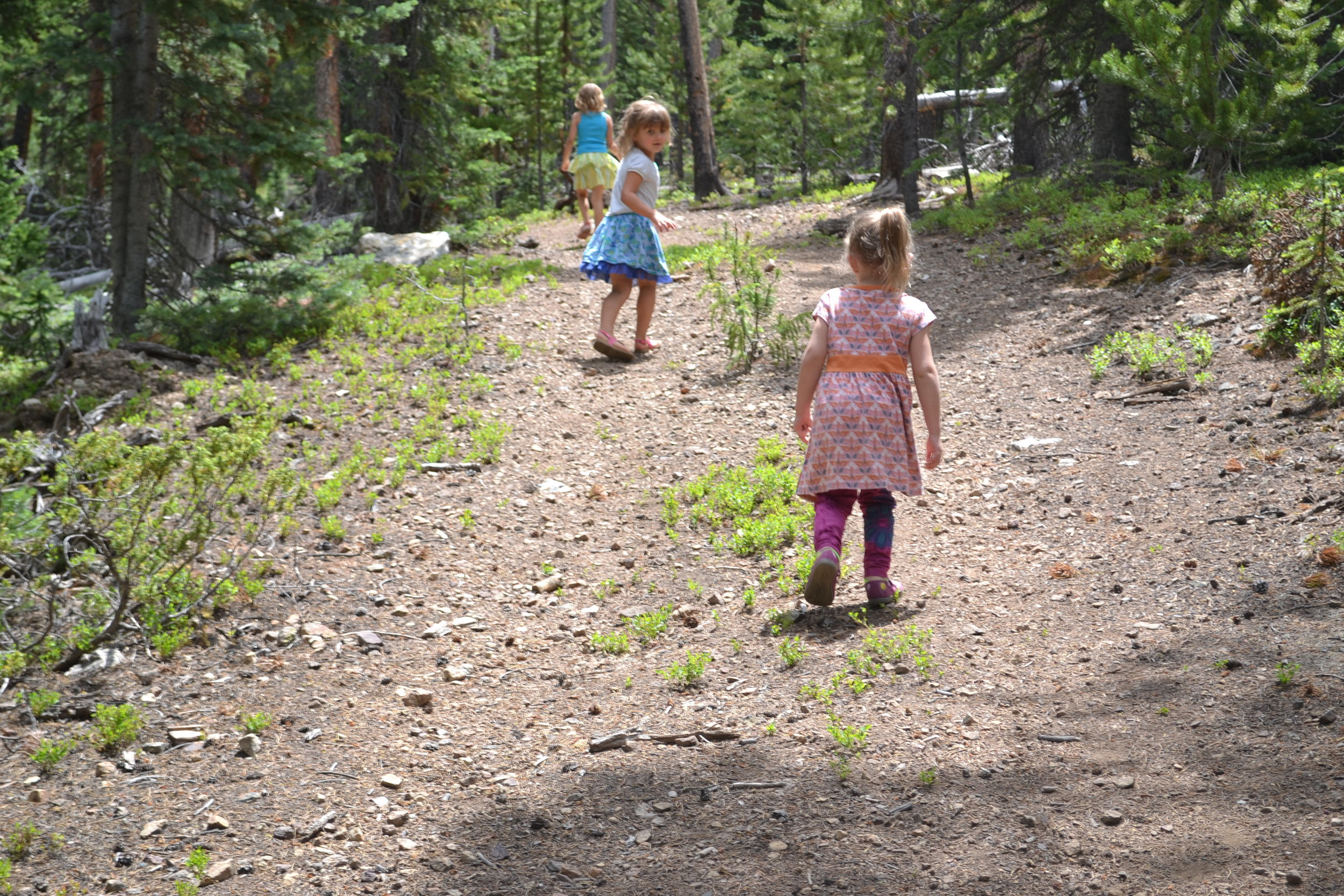 Girls run up a trail in Breckenridge CO