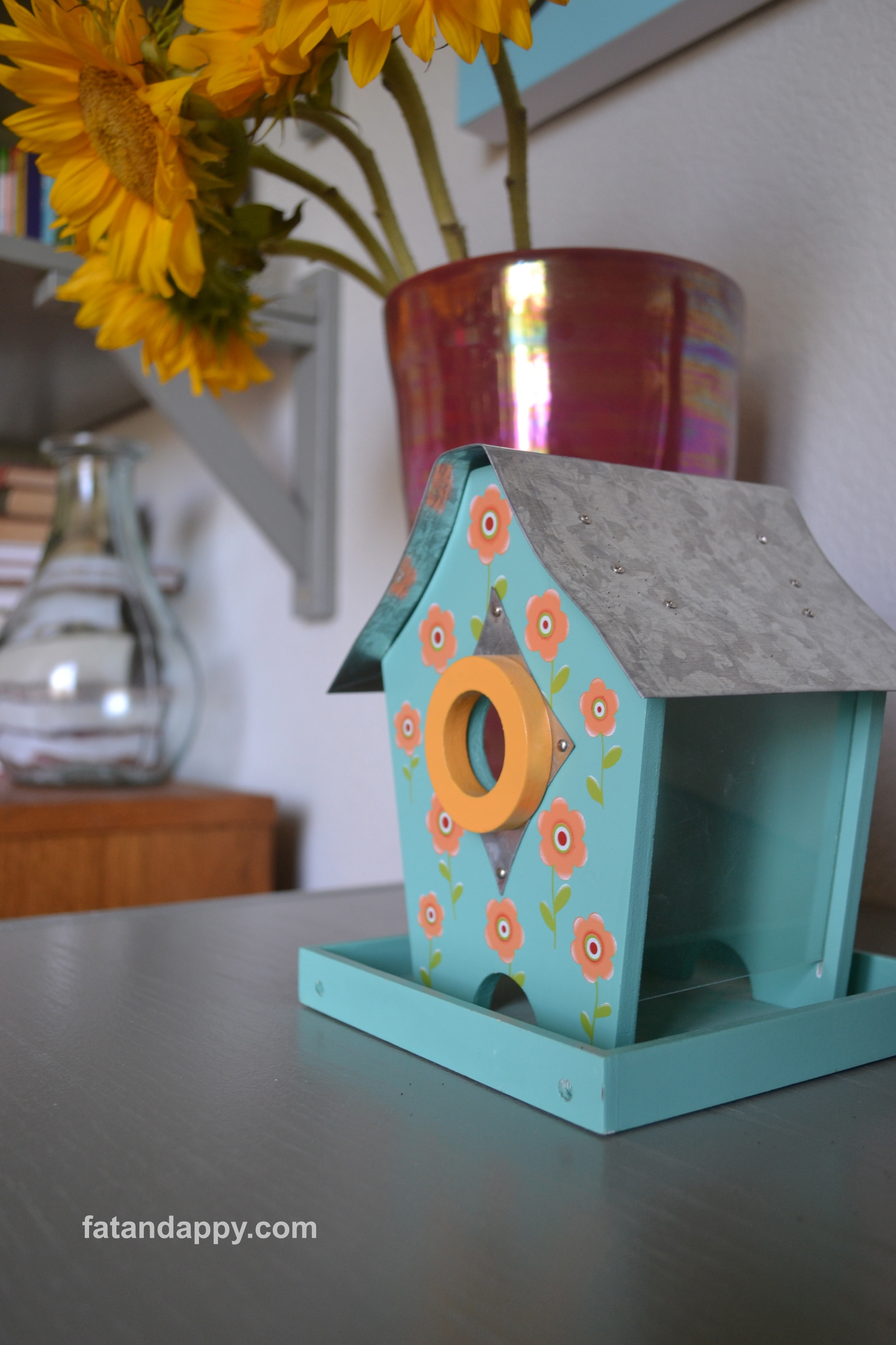 A picture of a colorful birdhouse from I Love Your Work, Jonathan Fenske