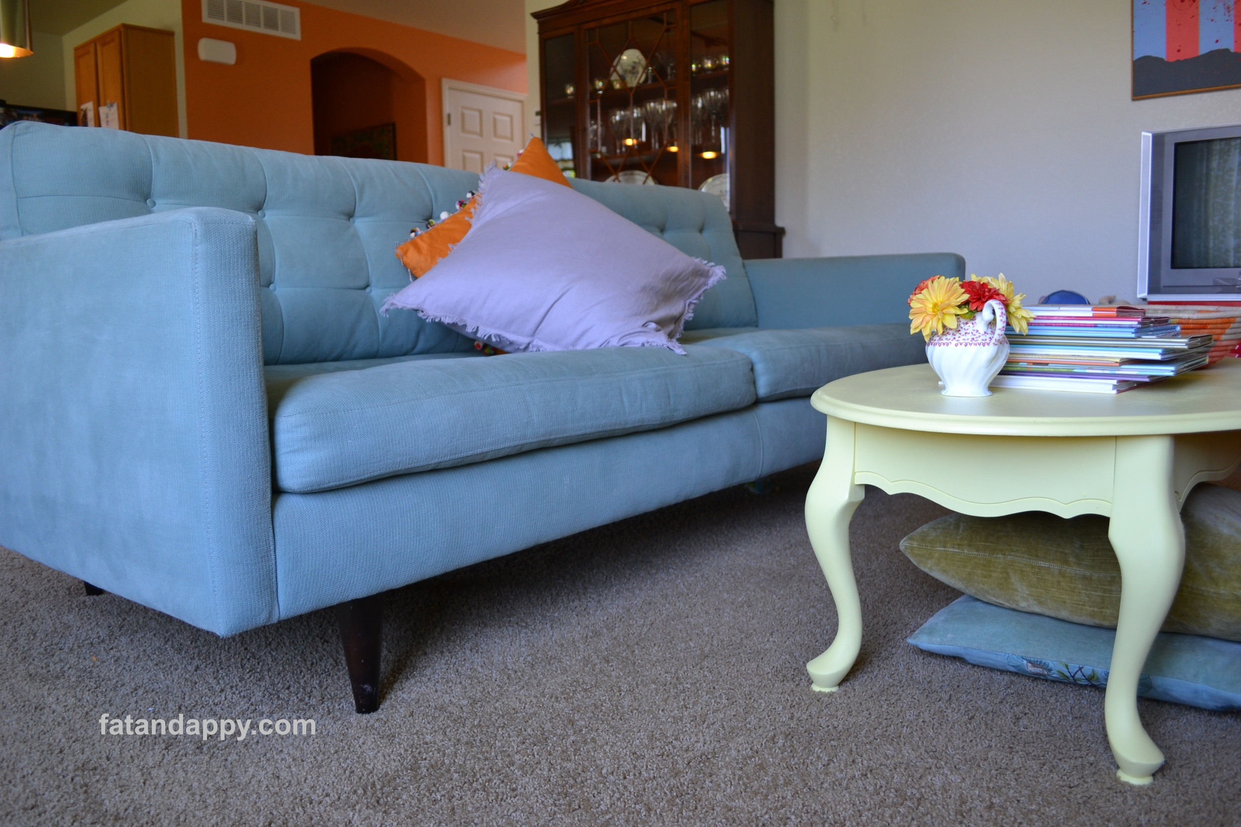 A Petrie couch with a yellow coffee table
