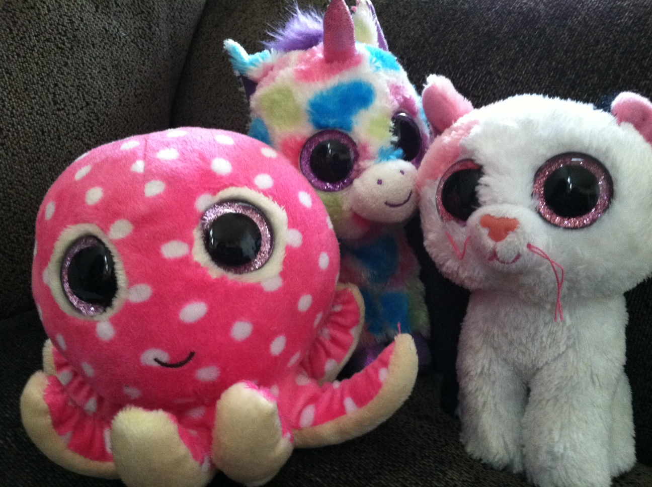 A picture of three Ty stuffed animals
