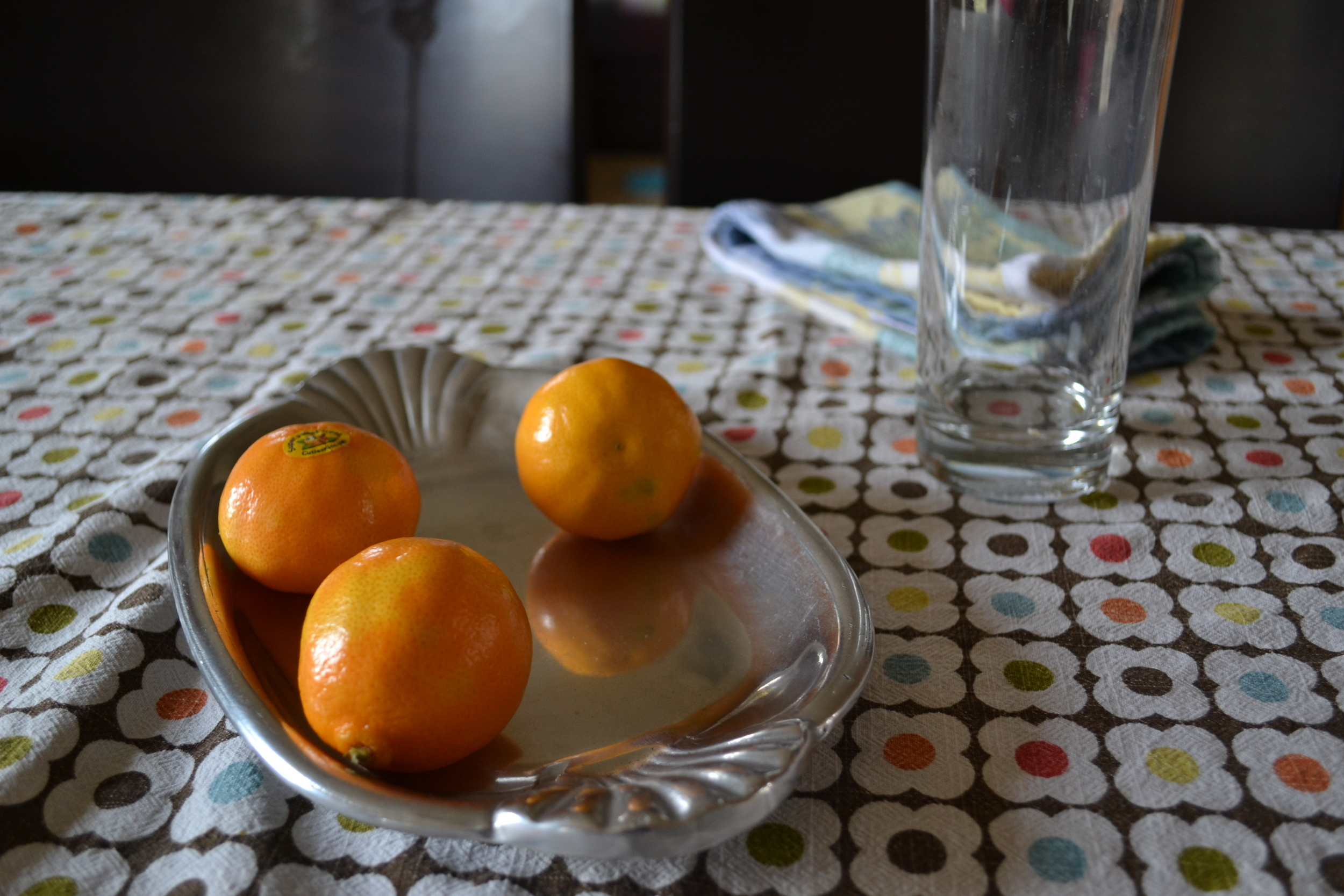A silver dish of oranges