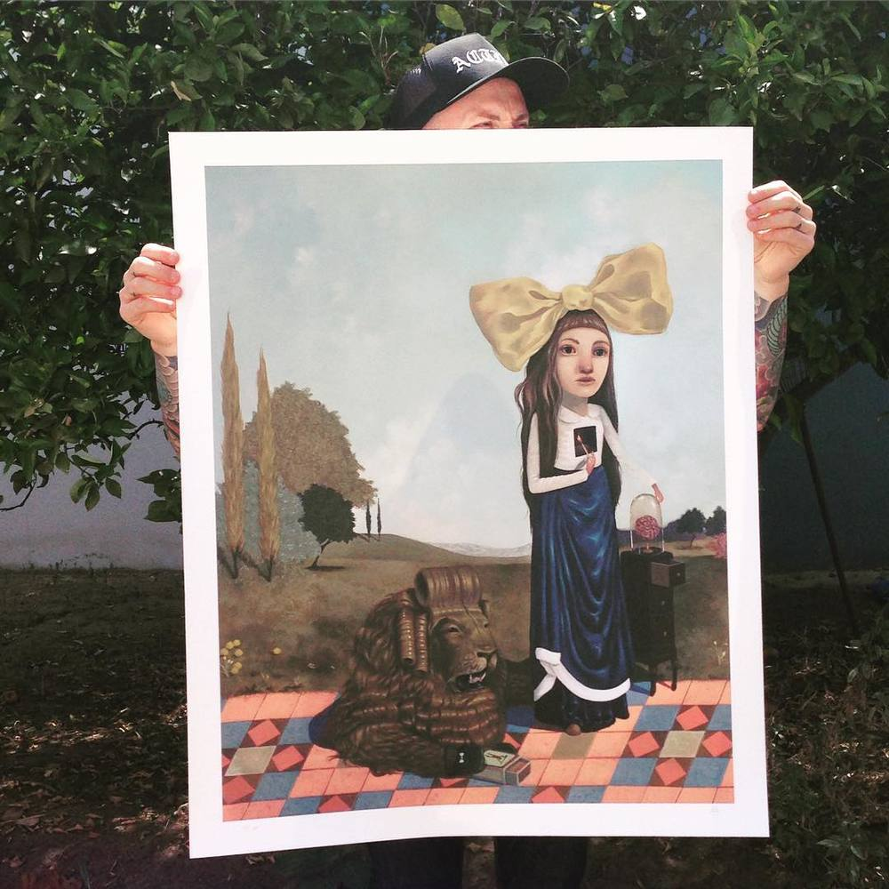 """I'm packing up my studio! Adding stuff to my shop all week as I 📦 away. You can take home this gorgeous archival paper edition of """"The Start of a Spark"""" right now. As modelled by my friend Jason, you can see how large it is. My cowardly lion wants to come live with you! 🏠 Image 30"""" x 24"""" on 240gsm watercolour paper archival inks. Edition of 25, only $75!! #lolagil #fineartprints"""