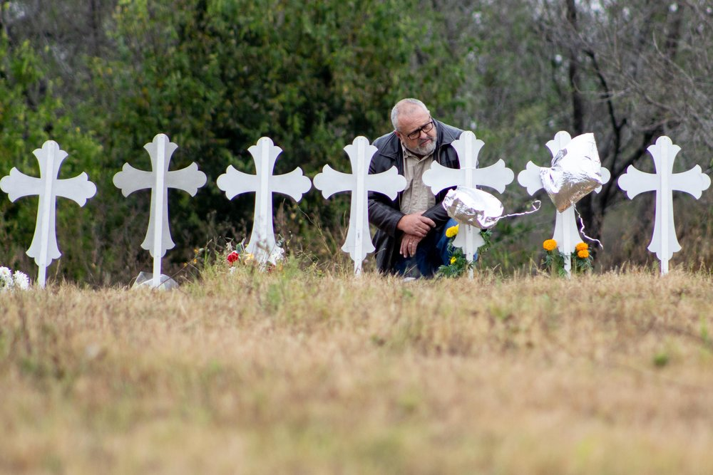 Carl Chinn, 58, kneels and prays in front of 26 metal crosses that honor the victims killed in a mass shooting at the First Baptist Church of Sutherland Springs on Nov. 5, 2017. Chinn said he traveled from Colorado Springs to seek understanding on how to make church congregations more secure.