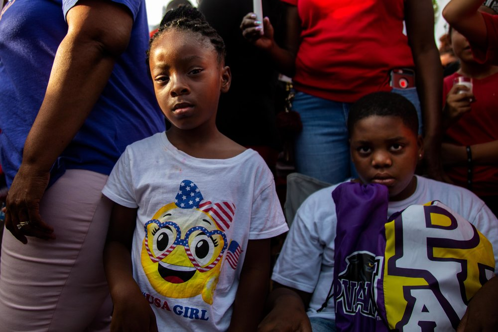 AUSTIN, TEXAS. July 6, 2018. Zerenity Richardson, 5, and her cousin Jordin Madyun, 12, watch the candlelight vigil honoring Devonte Ortiz, who was shot and killed on July 4, 2018, after a dispute over fireworks. Montinique Monroe for KUT News