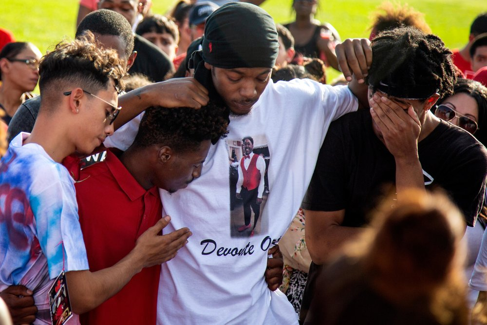 AUSTIN, TEXAS. July 6, 2018. Family, friends and community members gather for a vigil at Travis High School football field to honor Devonte Ortiz, 19, who was shot and killed on July 4, 2018, after a dispute over fireworks. Montinique Monroe for KUT News