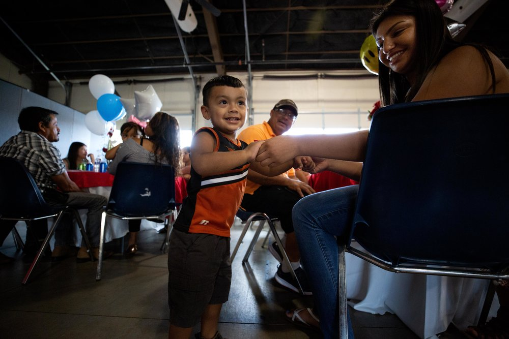 ROUND ROCK, TX. August 10, 2018. Santiago Garcia, 2, plays with his big cousin Andrea Orozco, as they await the arrival of Orozco's aunt whom she hasn't seen in over a decade. The Government of the State of Michoacán assisted parents with applying for tourist visas that will last for ten years. A program called Palomas Mensajeras (homing pigeons) came to the Austin area to reunite the families. Montinique Monroe for KUT News