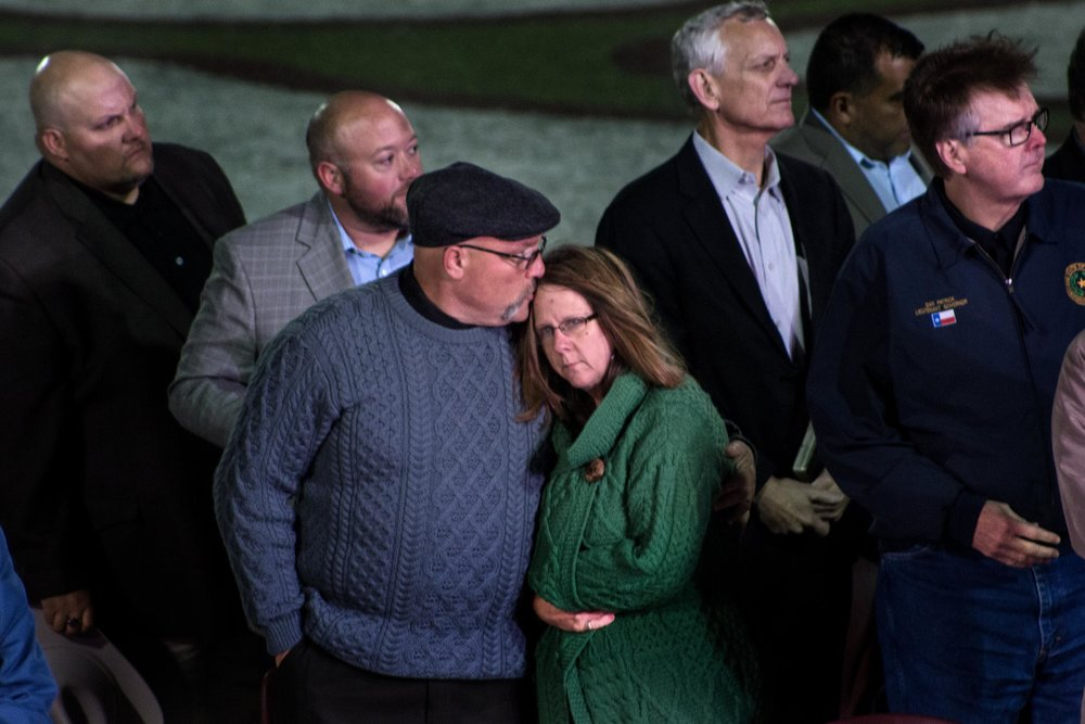 Pastor Frank Pomeroy consoles his wife Sherri Pomeroy as Vice President Mike Pence prepares to speak at a memorial service for victims killed in a church shooting in Sutherland Springs, Texas. On Nov. 5, 2017, a gunman opened fire at the First Baptist Church killing 26 people including the pastor's daughter.