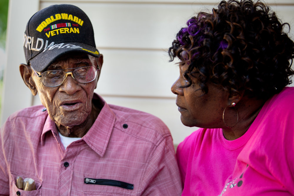 AUSTIN, TEXAS. May 11, 2018. Friends, family and community members celebrate America's oldest living WWII veteran Richard Overton, during a public party at his East Austin home for his 112th birthday. Montinique Monroe for KUT News