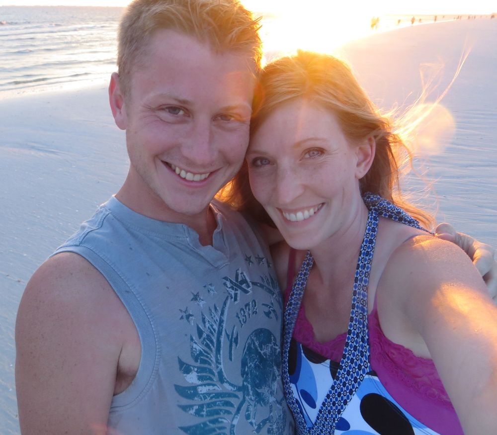 Laura and I revisiting our engagement site on Fort Myers Beach (2013)