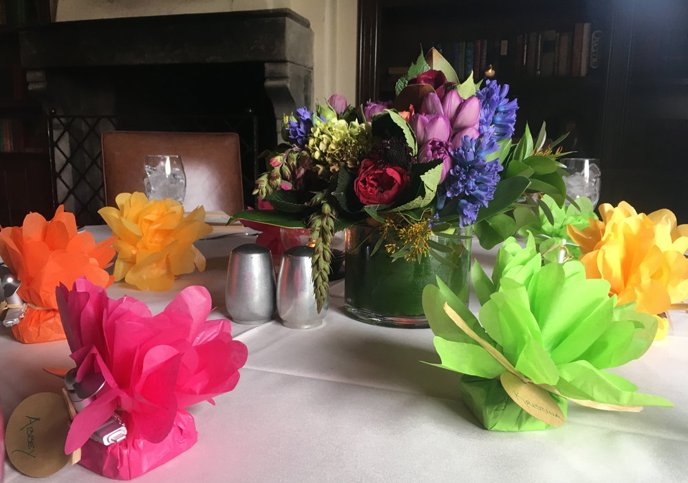 Favors and flowers adorn the library tables, ready for our guests.