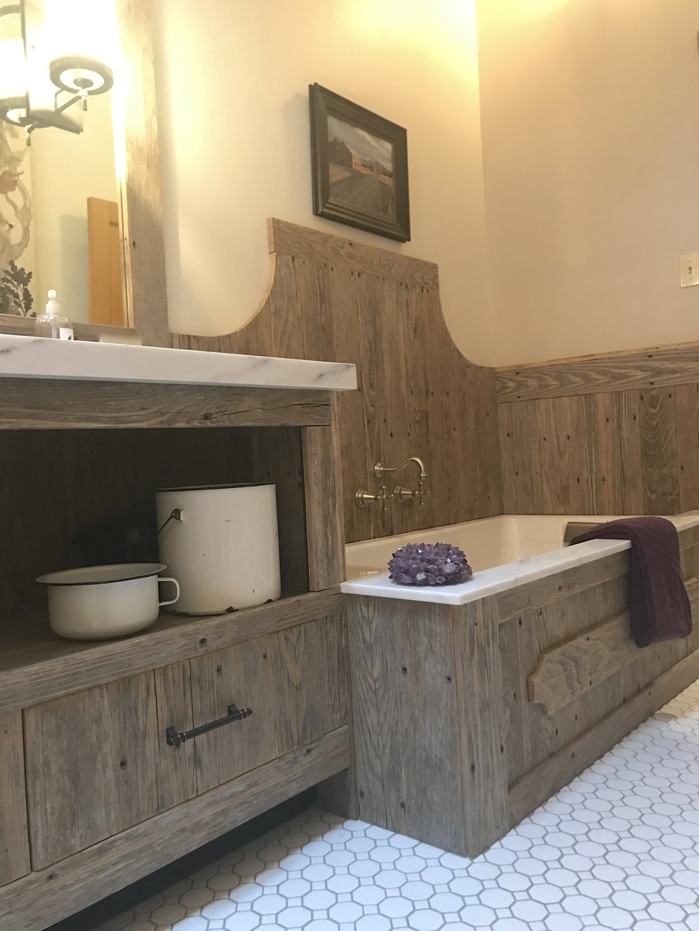 The vanity and tub surround are re-purposed from old cedar dock wood.