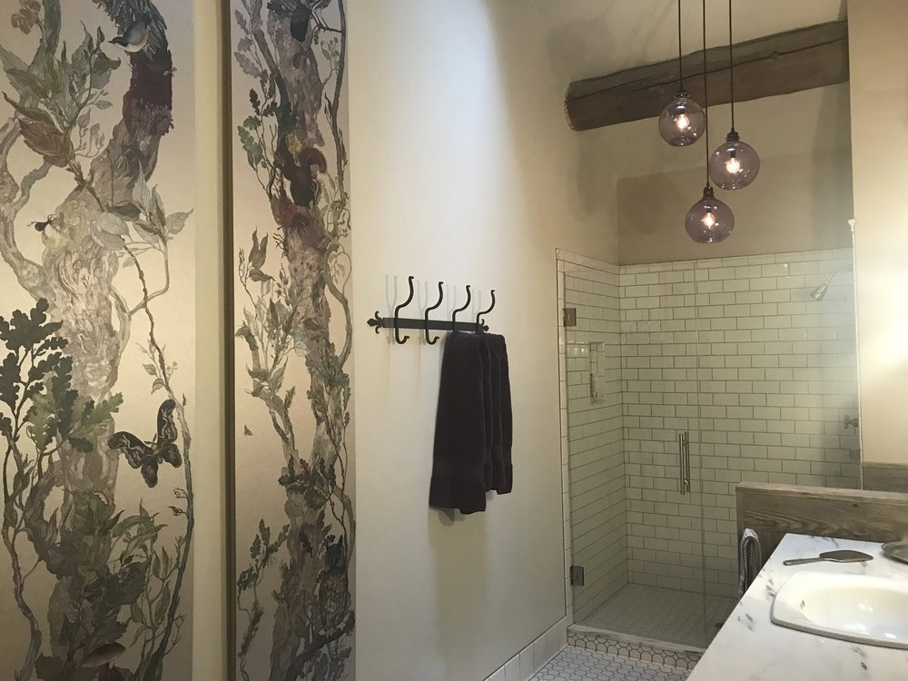 Mounted wallpaper panels as art in MT bath remodel by Jennifer