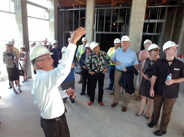 David gives visitors a tour of lobby - Tornillo project