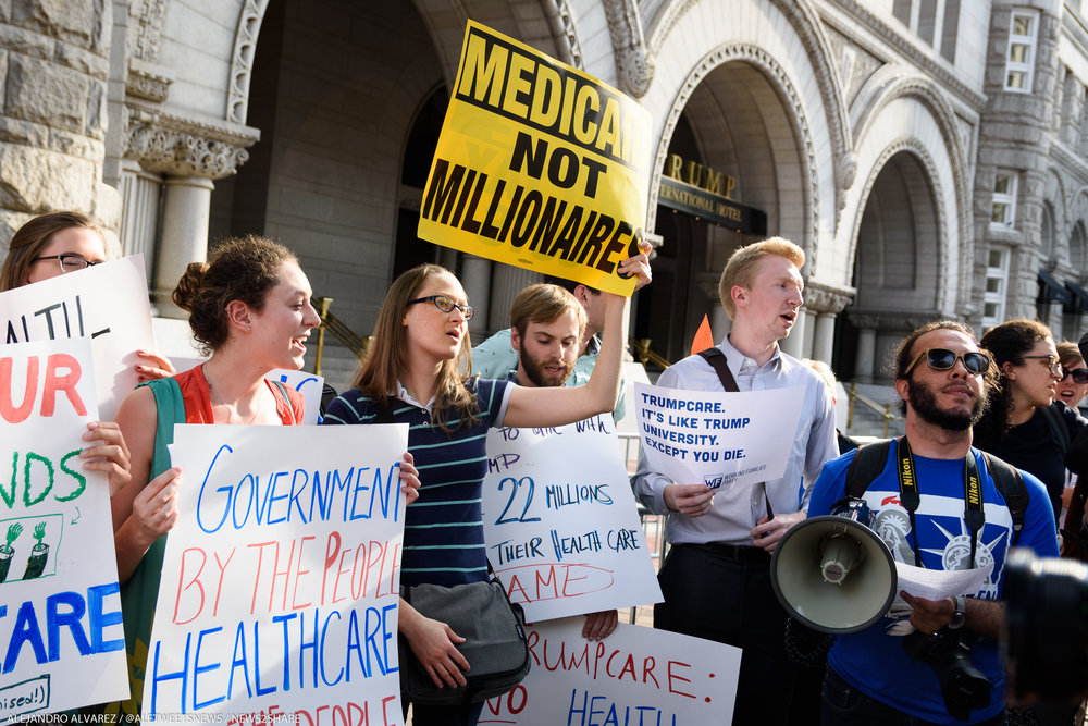 The scene outside Trump's Washington hotel on Thursday afternoon amid a protest against the GOP health plan during his first re-election fundraiser.