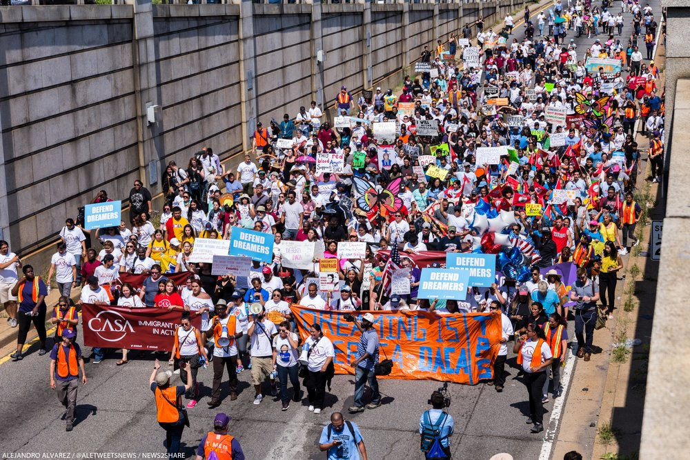 "A ""Defend DACA"" march of a few hundred moves into the 12th Street tunnel beneath the National Mall, on their way to ICE headquarters in southwest Washington."