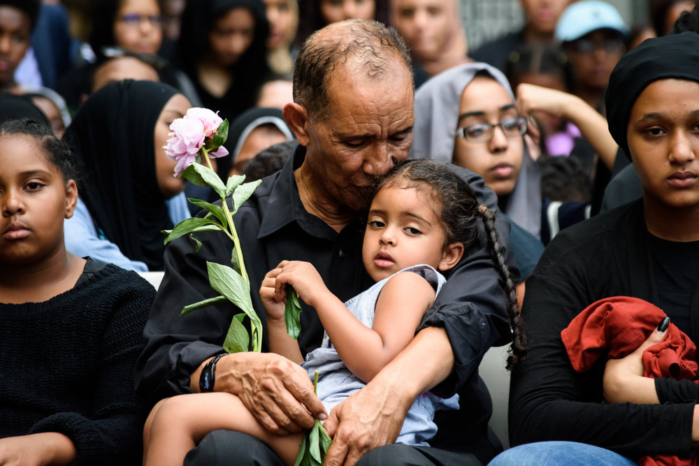 Mahmoud Hassanen embaces his daughter at a vigil slain Muslim teen Nabra Hassanen in Reston, Virginia on June 21, 2017. (Alejandro Alvarez / News2Share)