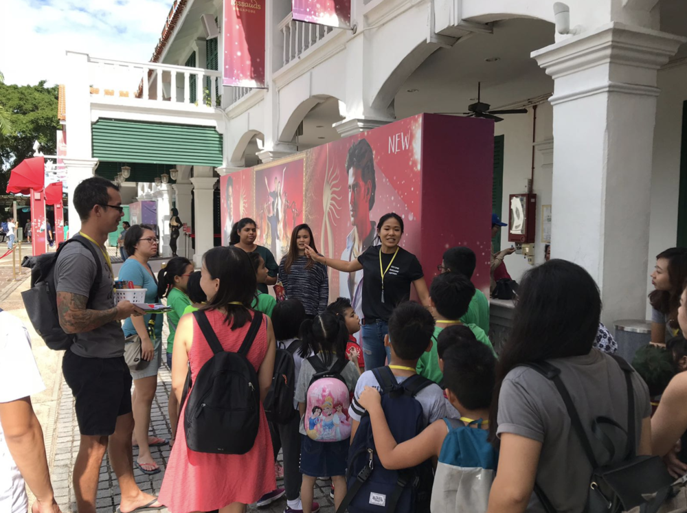 Joelle, leading a group of excited children and youth on a JalanJalan (field trip) to Madame Tussauds, Sentosa, Singapore!