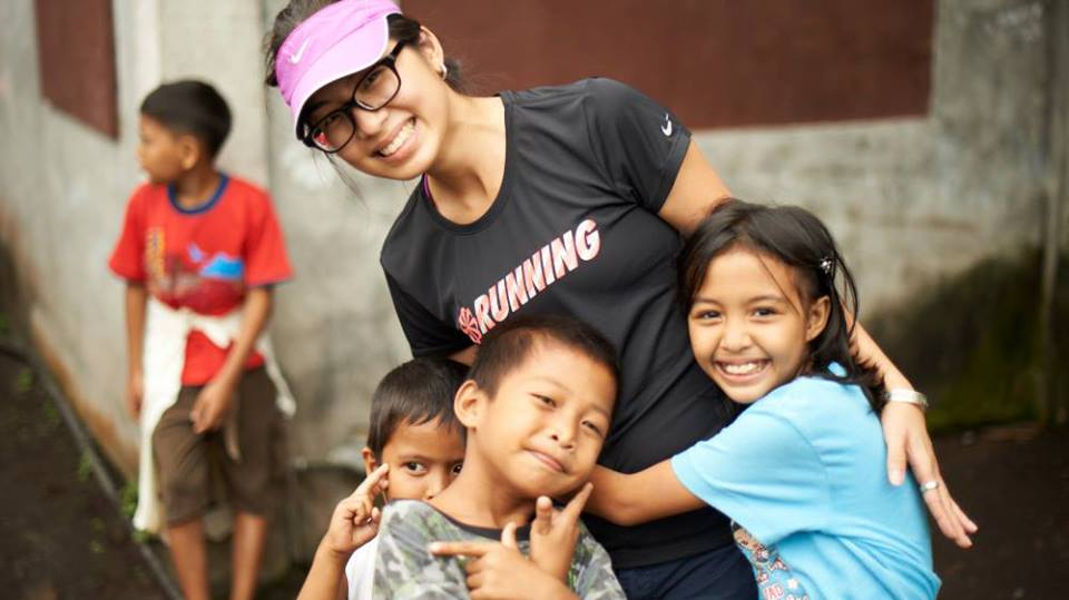 Emily with some kids in community in the Philippines.jpg