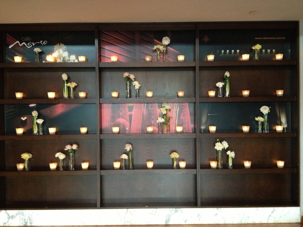 Candle and flower wall