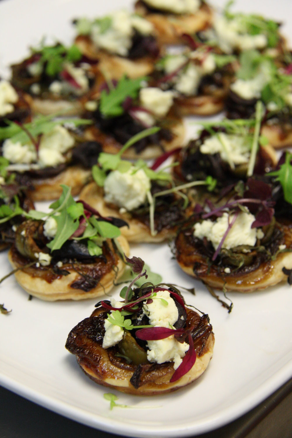 Pisaladier- mini tart with olives fetta and caramelised onion.JPG
