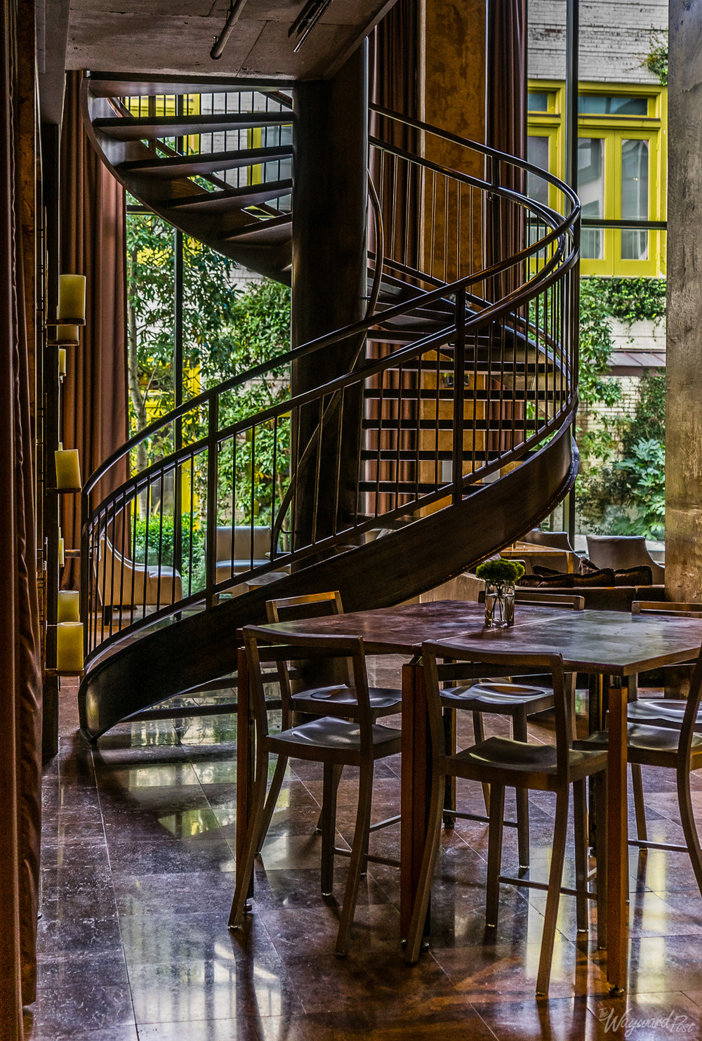 Spiral staircase to the lounge area and bluebell garden at the Proximity Hotel Greensboro North Carolina. Photo by Zygmunt Spray.